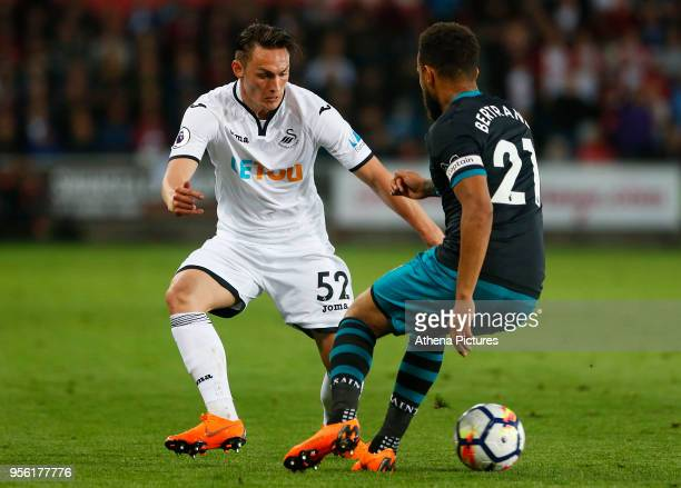 Connor Roberts of Swansea City is marked by Ryan Bertrand of Southampton during the Premier League match between Swansea City and Southampton at...