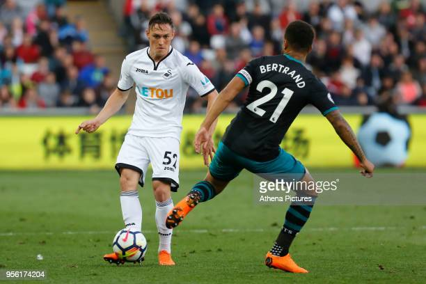 Connor Roberts of Swansea City kicks the ball past Ryan Bertrand of Southampton during the Premier League match between Swansea City and Southampton...