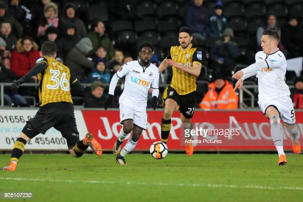 Connor Roberts of Swansea City shows team Nathan Dyer l where to pass the ball as he gets past Daniel Pudil and George Boyd of Sheffield Wednesday...