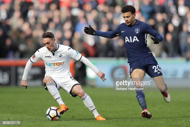 Connor Roberts of Swansea City turns on the ball under pressure from Dele Alli of Tottenham Hotspur during The Emirates FA Cup Quarter Final match...