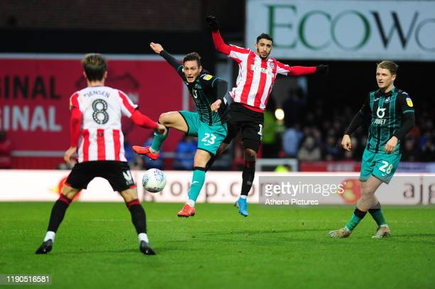 Connor Roberts of Swansea City under pressure from Saïd Benrahma of Brentford during the Sky Bet Championship match between Brentford and Swansea...