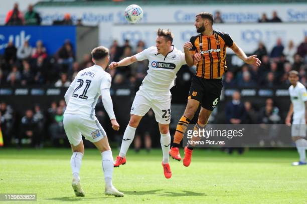 Connor Roberts of Swansea City vies for possession with Kevin Stewart of Hull City during the Sky Bet Championship match between Swansea City and...