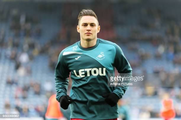 Connor Roberts of Swansea City warms up prior to the game during the Premier League match between Huddersfield Town and Swansea City and at the John...