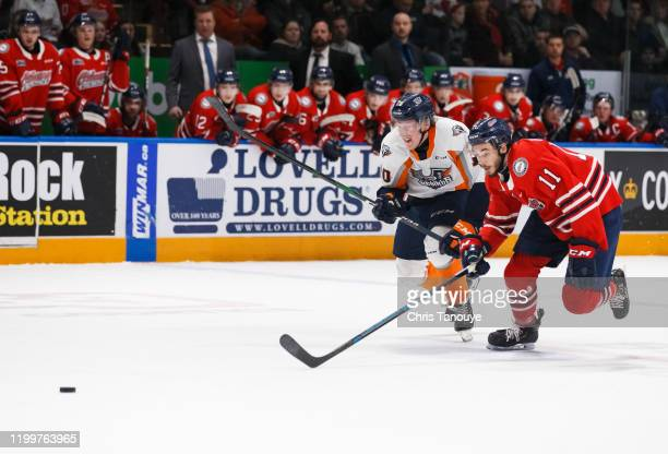 Connor Roberts of the Flint Firebirds and Giovanni Vallati of the Oshawa Generals race for a loose puck during an OHL game at the Tribute Communities...