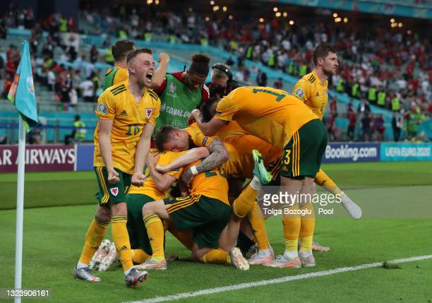 Connor Roberts of Wales celebrates with team mates after scoring their side's second goal during the UEFA Euro 2020 Championship Group A match...