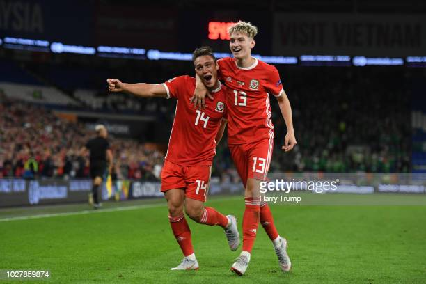 Connor Roberts of Wales celebrates with teammate David Brooks after scoring his team's fourth goal during the UEFA Nations League B group four match...