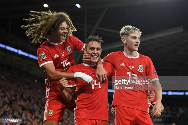 Connor Roberts of Wales celebrates with teammates after scoring his team's fourth goal during the UEFA Nations League B group four match between...