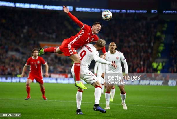 Connor Roberts of Wales wins a header over Nicolai Jorgensen of Denmark during the UEFA Nations League Group B match between Wales and Denmark at...