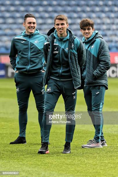 Connor Roberts Tom Carroll and Daniel James walk on the picth prior to the game during the Premier League match between Huddersfield Town and Swansea...