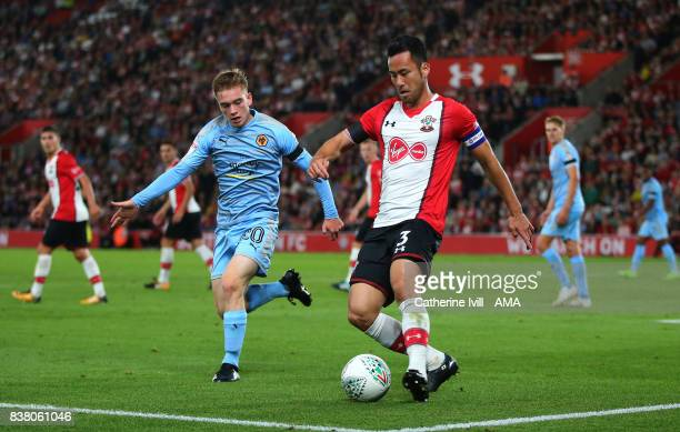 Connor Ronan of Wolverhampton Wanderers and Maya Yoshida of Southampton during the Carabao Cup Second Round match between Southampton and...