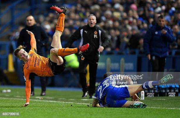 Connor Ronan of Wolverhampton Wanderers is fouled by Sam Hutchinson of Sheffield Wednesday during the Sky Bet Championship match between Sheffield...