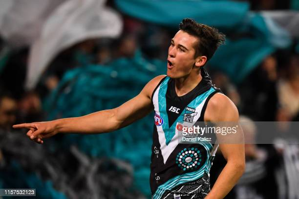 Connor Rozee of the Power celebrates after kicking a goal during the round 14 AFL match between the Port Adelaide Power and the Geelong Cats at...