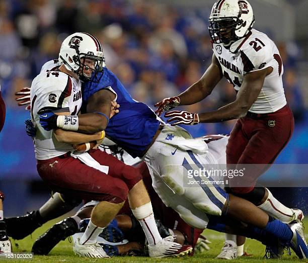 d128a847aba Connor Shaw of the South Carolina Gamecocks is tackled by Alvin Dupree of  the Kentucky Wildcats