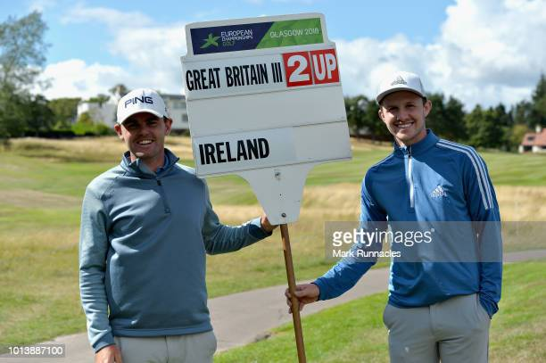 Connor Syme and Liam Johnston of Great Britain pose for a photo after winning match 4 of Group B during day two of the European Golf Team...