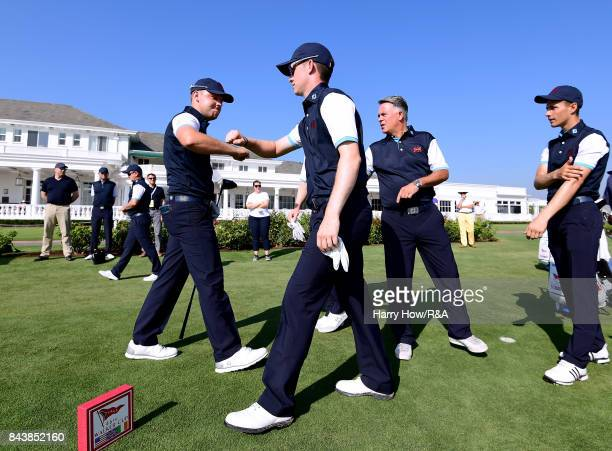 Connor Syme and Paul McBride of Great Britain and Ireland celebrate as they leave the first tee box with Acting Captain Andy Ingram and Matthew...
