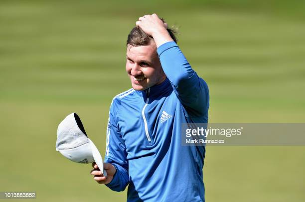 Connor Syme of Great Britain reacts after putting on hole seventeen during match 4 of Group B during day two of the European Golf Team Championships...