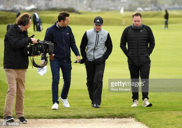 Connor Syme of Scotland is interviewed by Sky Sports during practice prior to the 2017 Alfred Dunhill Links Championship at The Old Course on October...
