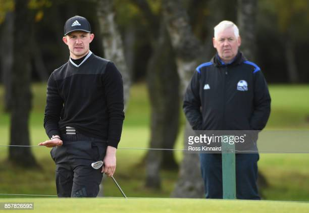 Connor Syme of Scotland plays his second shot on the 8th during day one of the 2017 Alfred Dunhill Championship at Carnoustie on October 5 2017 in St...