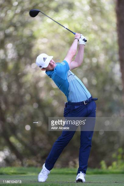 Connor Syme of Scotland plays his tee shot on the eighth during day 1 of the Challenge Tour Grand Final at Club de Golf Alcanada on November 07 2019...