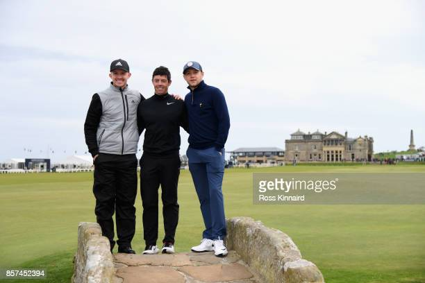 Connor Syme of Scotland Rory McIlroy of Northern Ireland and Musician Niall Horan pose for photos on the Swilken Bridge during practice prior to the...