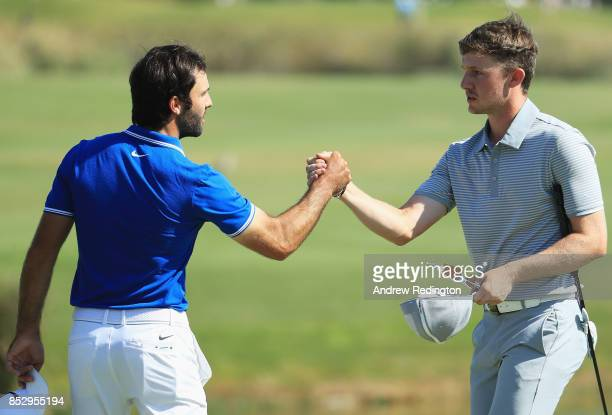 Connor Syme of Scotland shakes hands with Joel Stalter of France on the 18th green during day four of the Portugal Masters at Dom Pedro Victoria Golf...