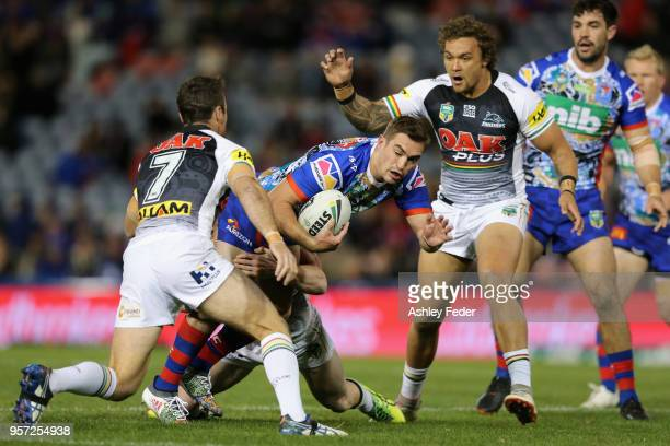 Connor Watson of the Knights is tackled by the Panthers defence during the round 10 NRL match between the Newcastle Knights and the Penrith Panthers...