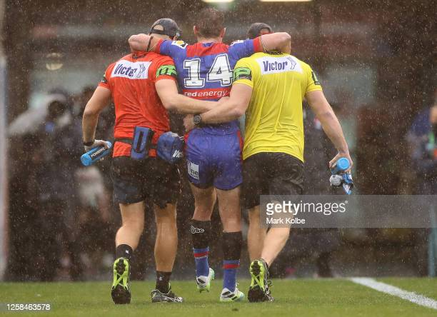 Connor Watson of the Knights is taken from the ground during the round 11 NRL match between the Newcastle Knights and the Canterbury Bulldogs at...