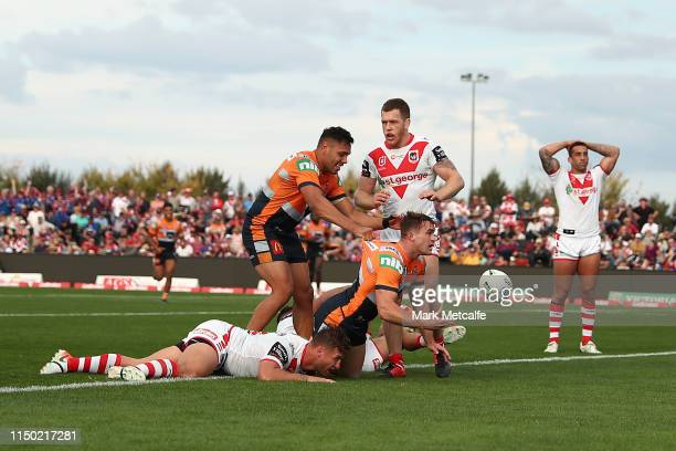 Connor Watson of the Knights scores a try during the round 10 NRL match between the St George Illawarra Dragons and the Newcastle Knights at Glen...