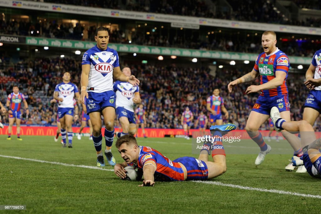 Connor Watson of the Knights scores a try during the round 16 NRL match between the Newcastle Knights and the Canterbury Bulldogs at McDonald Jones Stadium on June 30, 2018 in Newcastle, Australia.