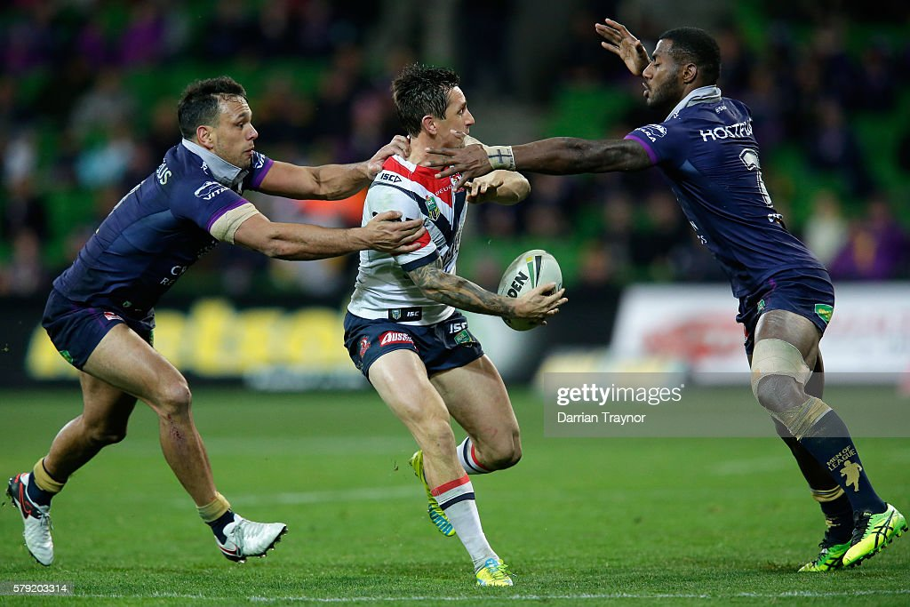 Connor Watson of the Roosters passes the ball during the round 20 NRL match between the Melbourne Storm and the Sydney Roosters at AAMI Park on July 23, 2016 in Melbourne, Australia.