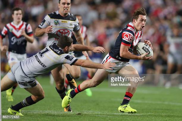 Connor Watson of the Roosters takes on Lachlan Coote of the Cowboys to score a try during the NRL Preliminary Final match between the Sydney Roosters...