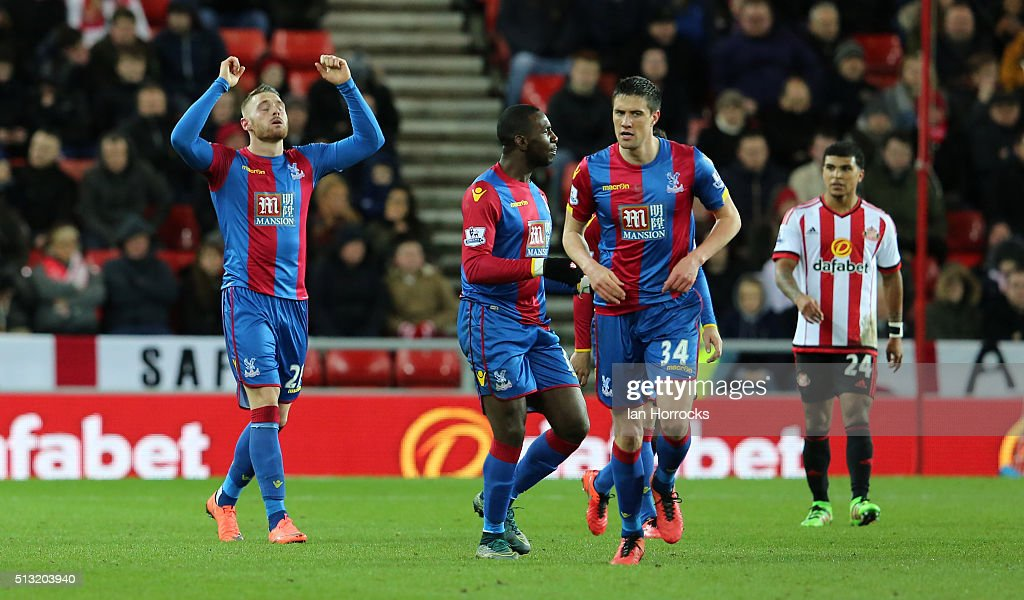 Connor Wickham of Crystal Palace (L) celebrates after scoring his sides first goal during the Barclays Premier League match between Sunderland and Crystal Palace at the Stadium of Light on March 01, 2016 in Sunderland, England.
