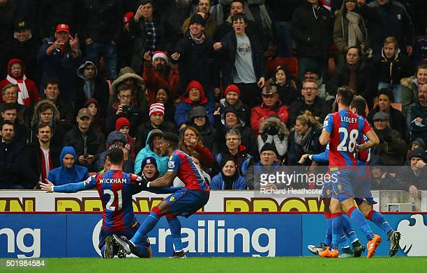 Connor Wickham of Crystal Palace celebrates scoring his team's first goal with his team mates during the Barclays Premier League match between Stoke...