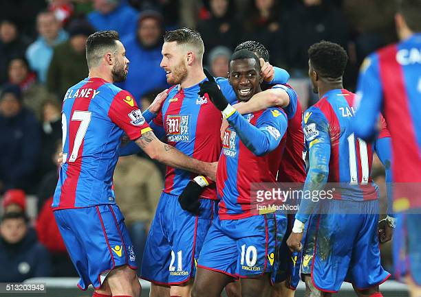 Connor Wickham of Crystal Palace celebrates scoring his team's first goal with his team mates during the Barclays Premier League match between...