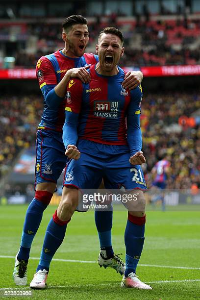 Connor Wickham of Crystal Palace celebrates with Joel Ward as he scores their second goal with a header during The Emirates FA Cup semi final match...