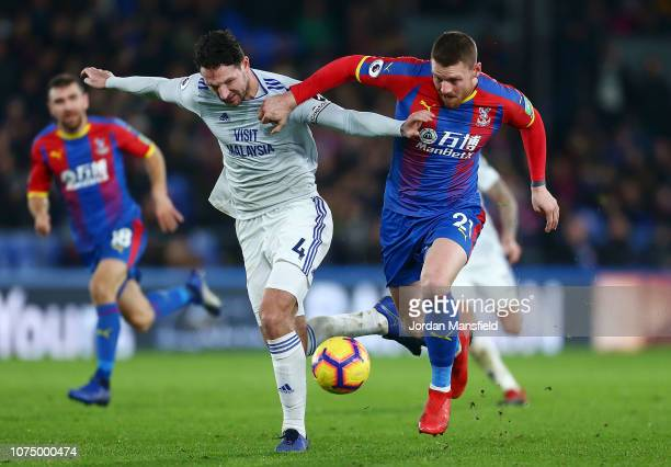 Connor Wickham of Crystal Palace challenges for the ball with Sean Morrison of Cardiff City during the Premier League match between Crystal Palace...