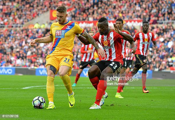 Connor Wickham of Crystal Palace is challenged by Lamine Kone of Sunderland in the second half during the Premier League match between Sunderland FC...