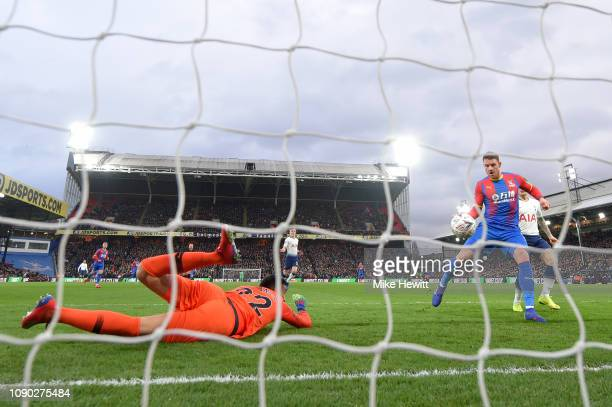 Connor Wickham of Crystal Palace scores his team's first goal past Paulo Gazzaniga of Tottenham Hotspur during the FA Cup Fourth Round match between...