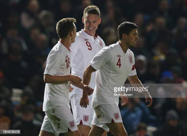 Connor Wickham of England celebrates with Josh McEachran and Jason Lowe as he scores their fourth goal during the International friendly match...