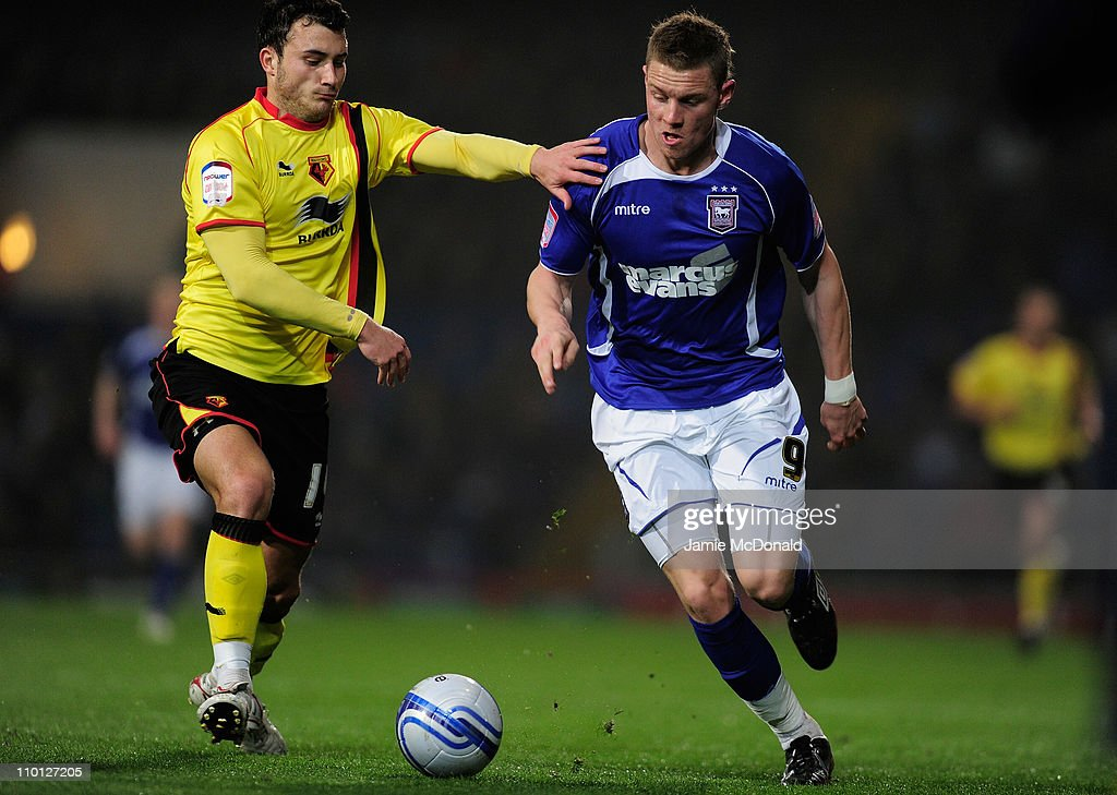 Connor Wickham of Ipswich Town battles with Will Buckley of Watford during the npower Championship match between Ipswich Town and Watford at Portman Road on March 15, 2011 in Ipswich, England.