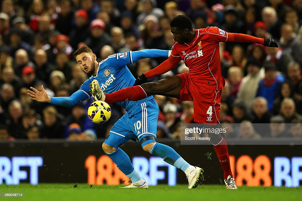 Connor Wickham of Sunderland battles for the ball with Kolo Toure of Liverpool during the Barclays Premier League match between Liverpool and Sunderland at Anfield on December 6, 2014 in Liverpool, England.
