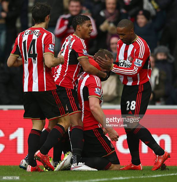 Connor Wickham of Sunderland celebrates with team mates after scoring the opening goal uring the Barclays Premier League match between Sunderland and...