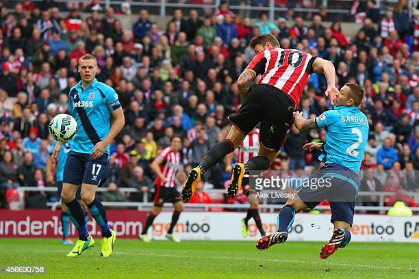 Connor Wickham of Sunderland heads the ball to score the opening goal during the Barclays Premier League match between Sunderland and Stoke City at...