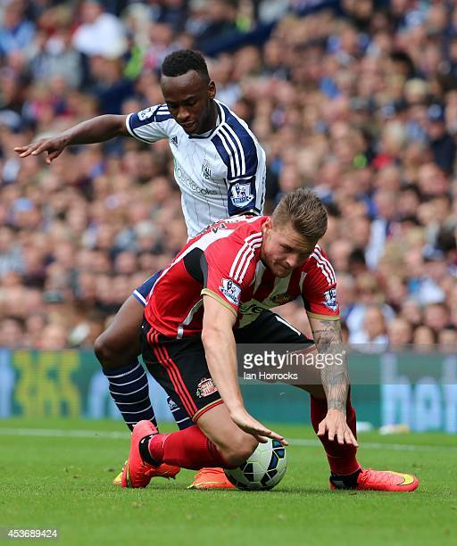 Connor Wickham of Sunderland is harried by Saido Berehino of West Bromwich Albion during the Barclays Premier League match between West Bromwich...