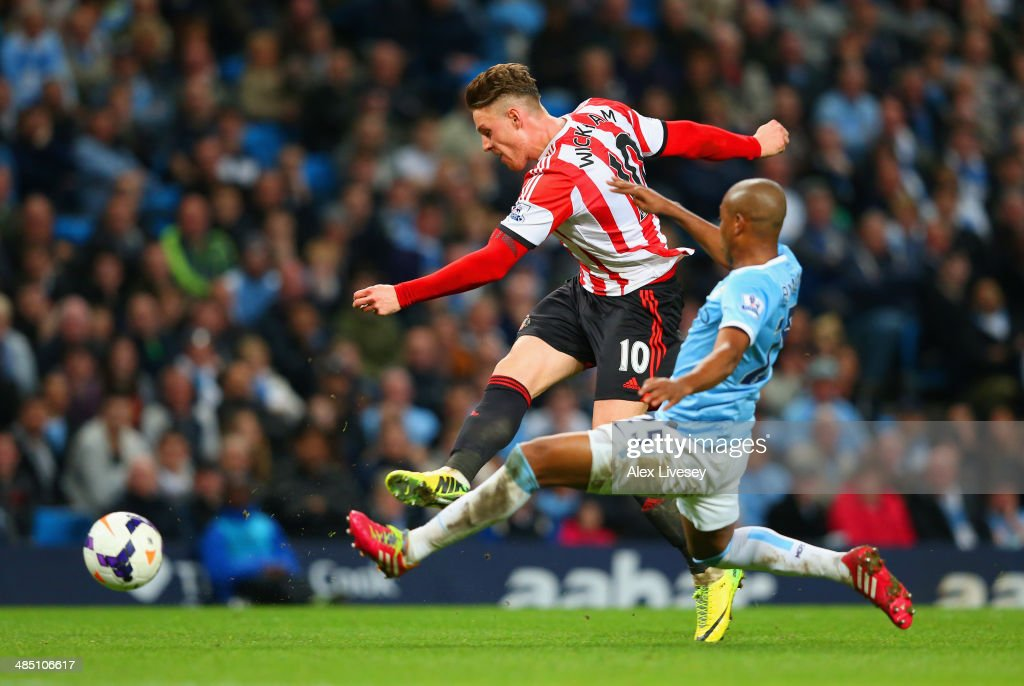 Connor Wickham of Sunderland scores their second goal under pressure from Fernandinho of Manchester City during the Barclays Premier League match between Manchester City and Sunderland at Etihad Stadium on April 16, 2014 in Manchester, England.