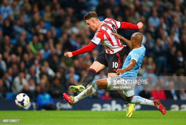 Connor Wickham of Sunderland scores their second goal under pressure from Fernandinho of Manchester City during the Barclays Premier League match...