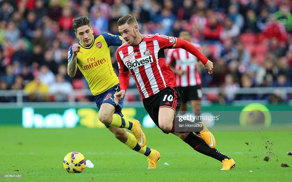 Connor Wickham of Sunderland (R) takes on Hector Bellerini of Arsenal (R) during the Barclays Premier League match between Sunderland AFC and Arsenal FC at The Stadium of Light on October 25, 2014 in Sunderland, England.