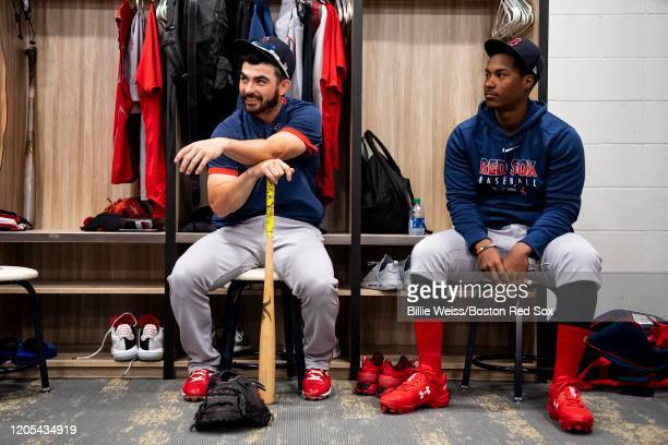 Connor Wong and Jeter Downs of the Boston Red Sox react before a Grapefruit League game against the Atlanta Braves on March 6 2020 at CoolToday Park...