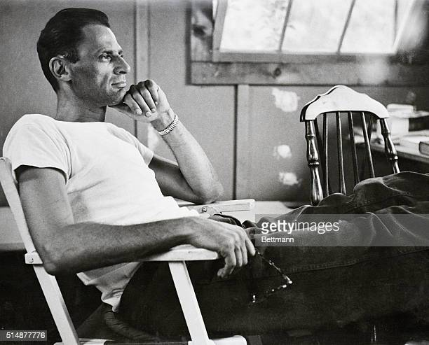 6/21/56NEW MILFORD CONNWorldfamous playwright Arthur Miller author of 'Death of a Salesman' other hits is shown in a reflective mood as he sits in...