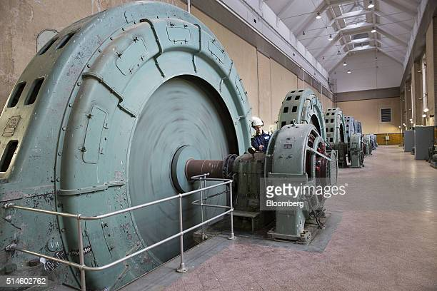 Conny Andersson a service technician for Bilfinger SE inspects a turbine at the Ultra Hydroelectric power station operated by Fortum Oyj in Tierp...